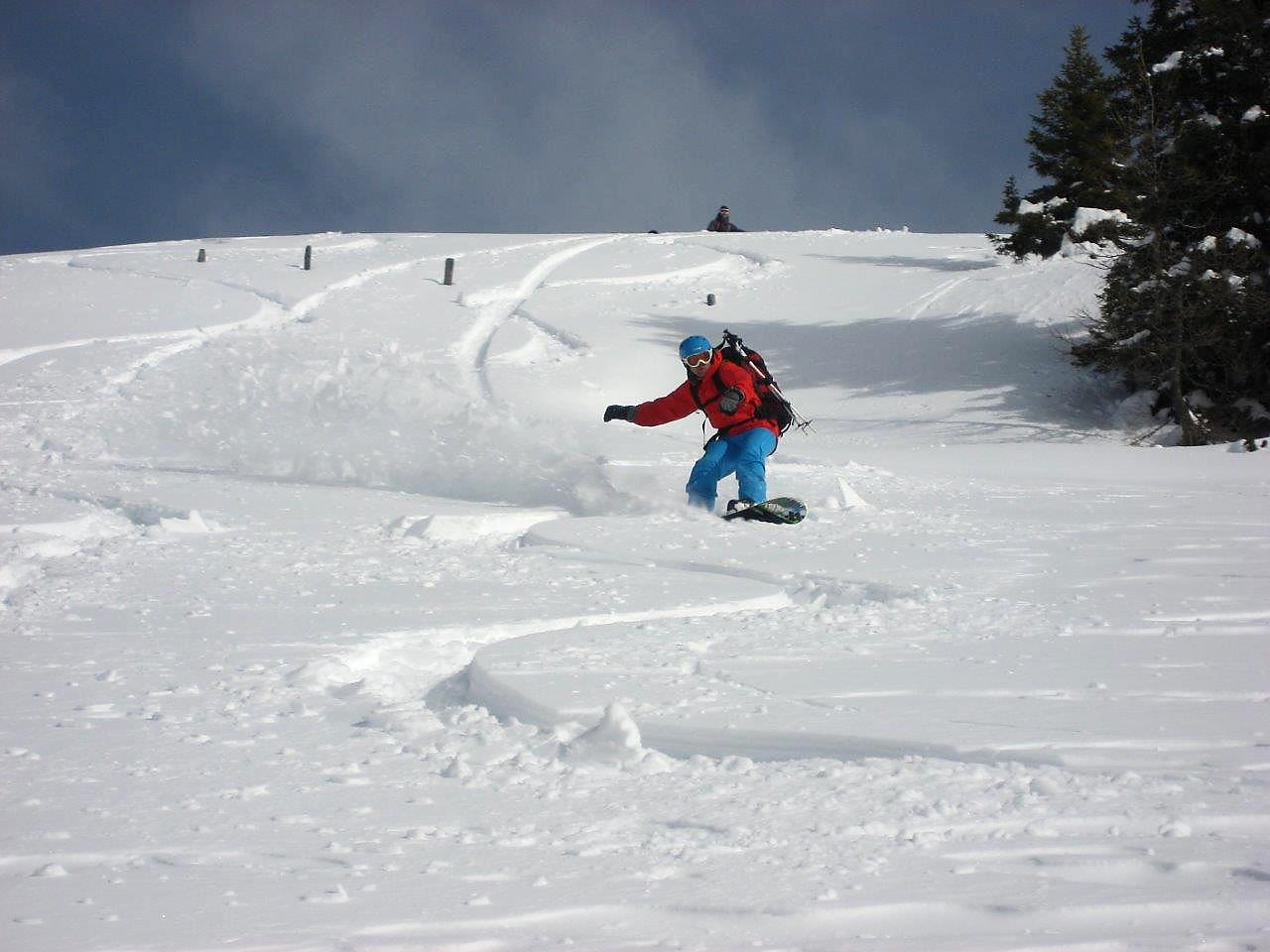 Powderfun mit dem Snowboard.