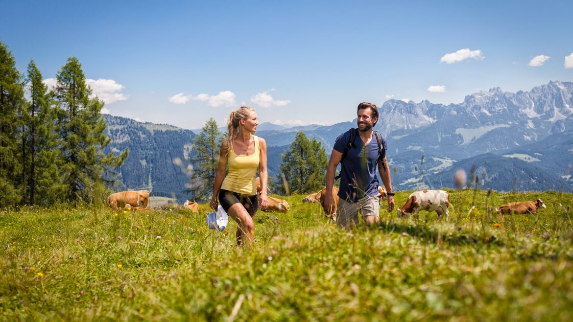 Couple hiking in the pastures