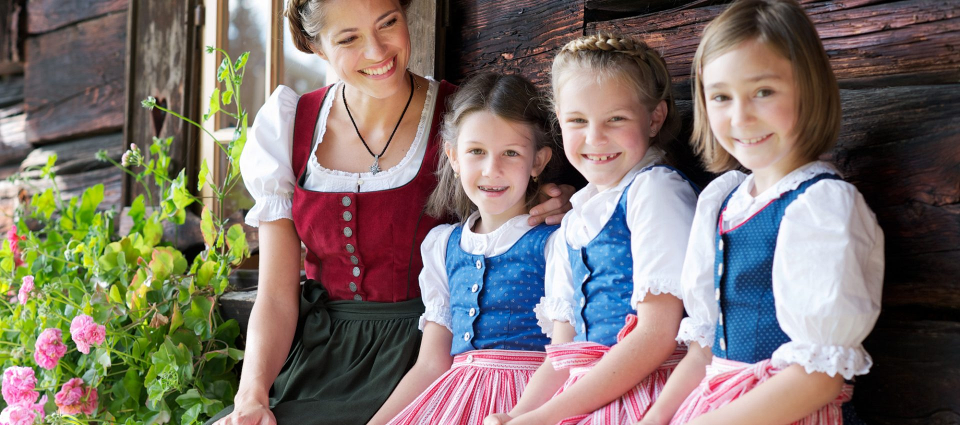 Woman with 3 girls in traditional costumes