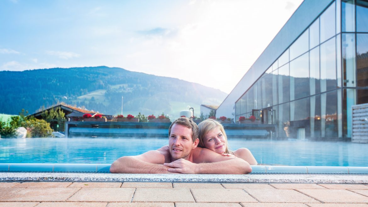 Couple enjoys the sauna pool outside