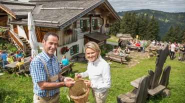 Alexandra collecting herbs at the Buergl-Alm