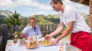 Alexandra eats delicious food at the Twenger Alm