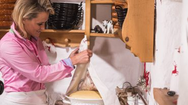 Alexandra prepares the dough for the farmers doughnuts