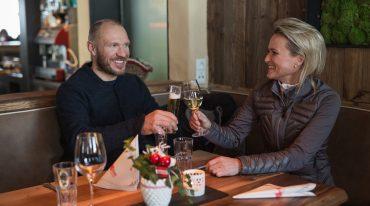 Alexandra Meissnitzer and Hermann Maier enjoy the evening at the Herzerlalm